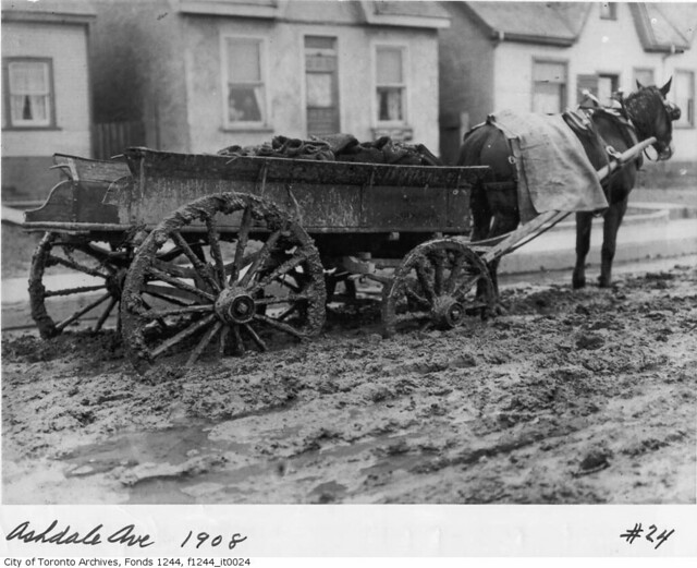 For millennia draft animals have assisted in material handling. This horse-drawn coal wagon stalled on muddy Ashdale Ave. Photo: William James, 1908, from the City of Toronto Archives.
