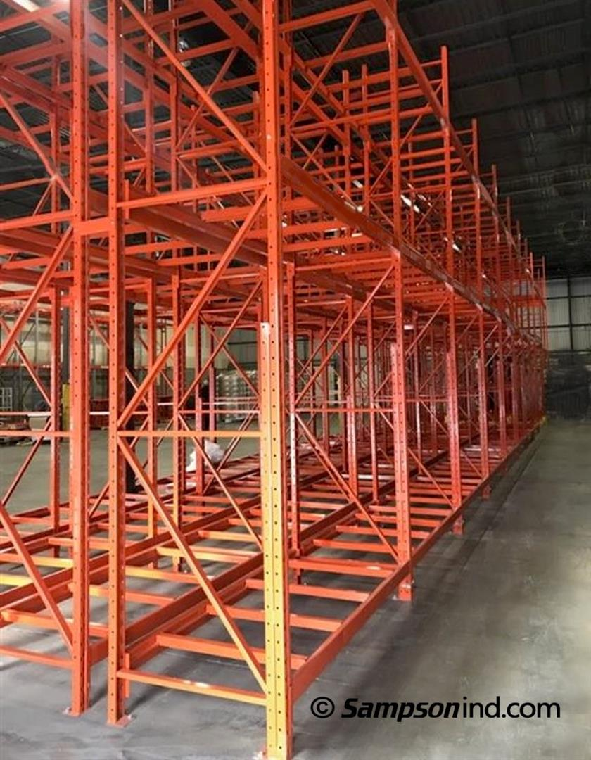Two rows of pallet Redirack racking joined by row spacers that enhance stability.